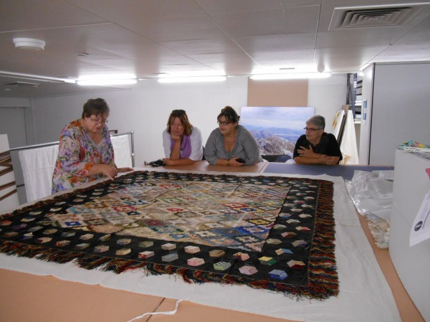 From left Shawn Fawcett, Joanne McLogan, Jenny Knight and Vicki Stockton with the Hexagon Quilt.