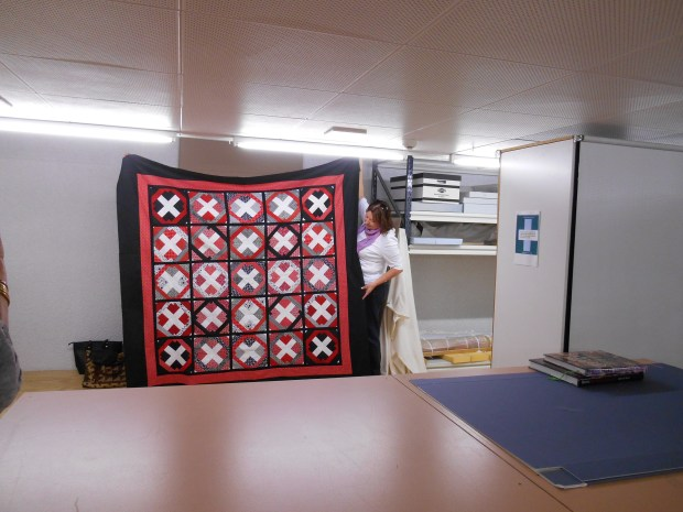 Joanne McLogan holding Jenny Knight's quilt.