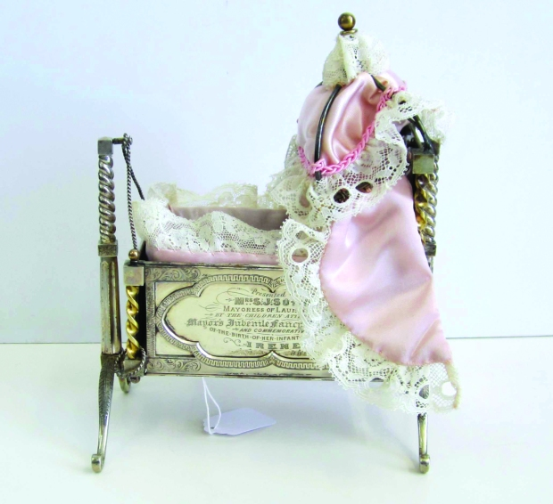 Presentation cradle 1890. Silver and gold plate, satin cloth, lace. QVMAG collection.