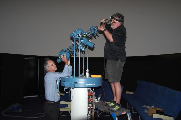 Chris Arkless (left) and Mario Rauh performing maintenance on the Zeiss ZKP3 projector.