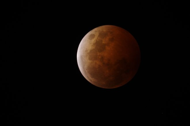 Caption for photo:  Last October's lunar eclipse at the beginning of totality.  Photo:  Martin George
