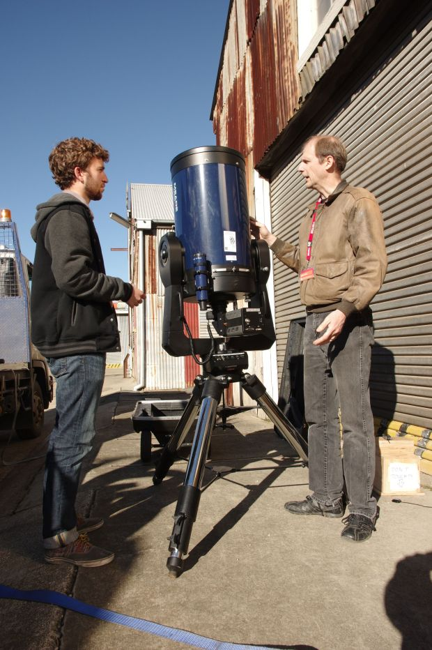 One is an image of Charles Watson (left) and Jeff Regester.  Suggested caption:  US astronomers Charles Watson and Jeff Regester testing their portable equipment in readiness for the Pluto occultation.   CREDIT: QVMAG