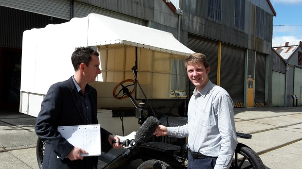 QVMAG History Curator Jon Addison  and ABC News Journalist Damian McIntyre with the 1919 Model T Ford ambulance